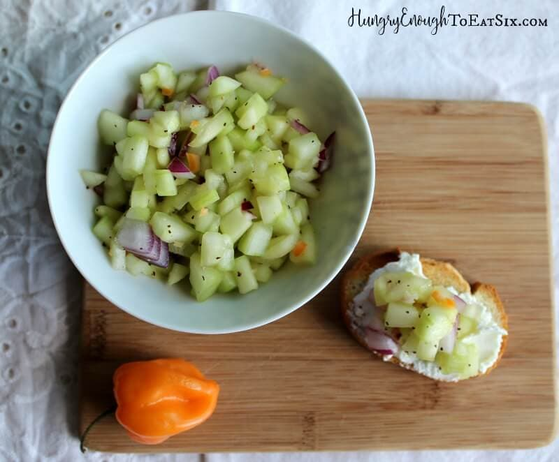 A refreshing salsa with cool cucumbers and habanero heat. It is served on sourdough slices with soft chevre cheese.