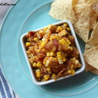 Image of Corn, Vidalia Onion and Bacon Salsa in a square dish with tortilla chips.
