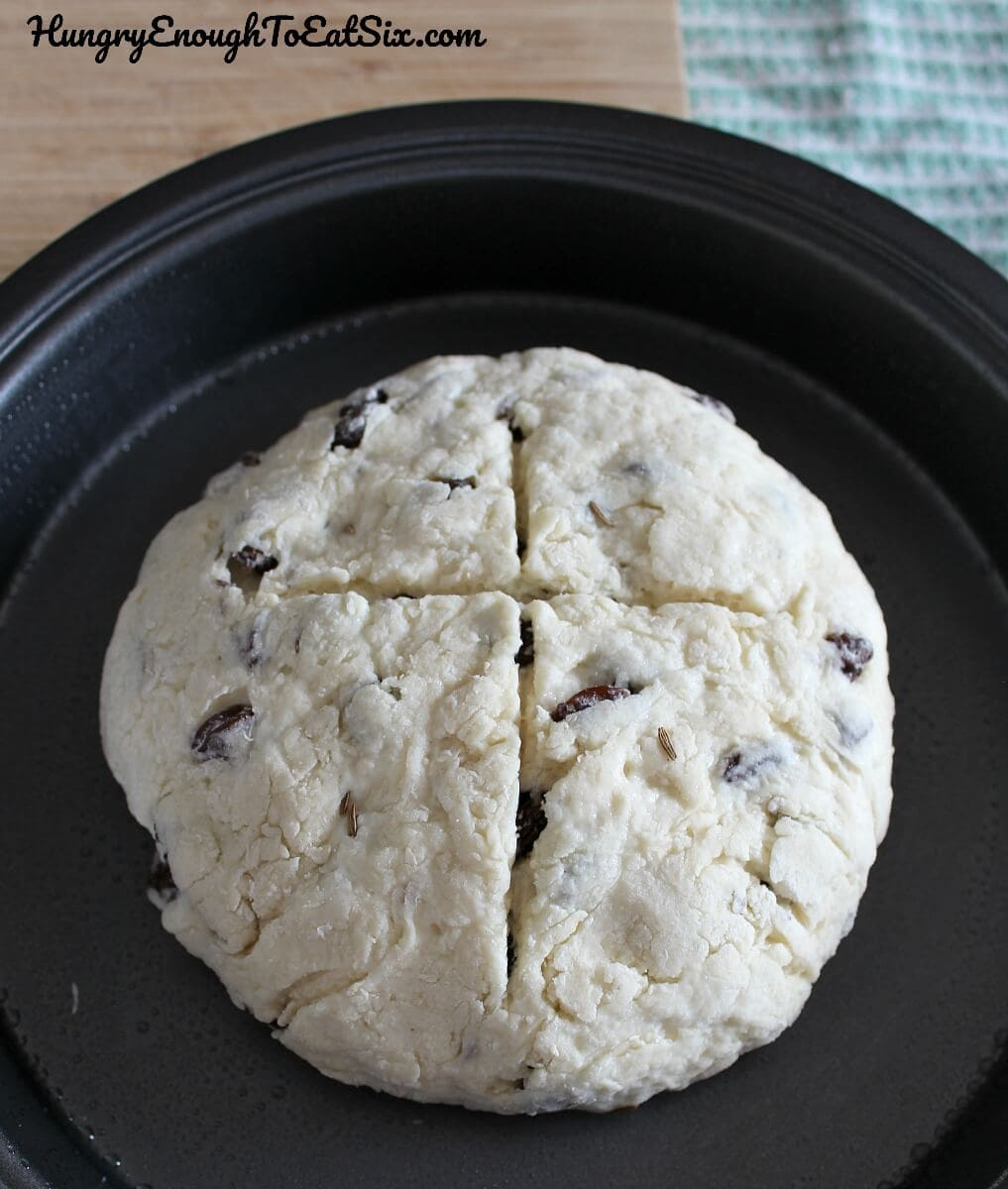 Image of scored and shaped loaf of Aunt Lizzy's Irish Soda Bread in baking pan ready for oven.