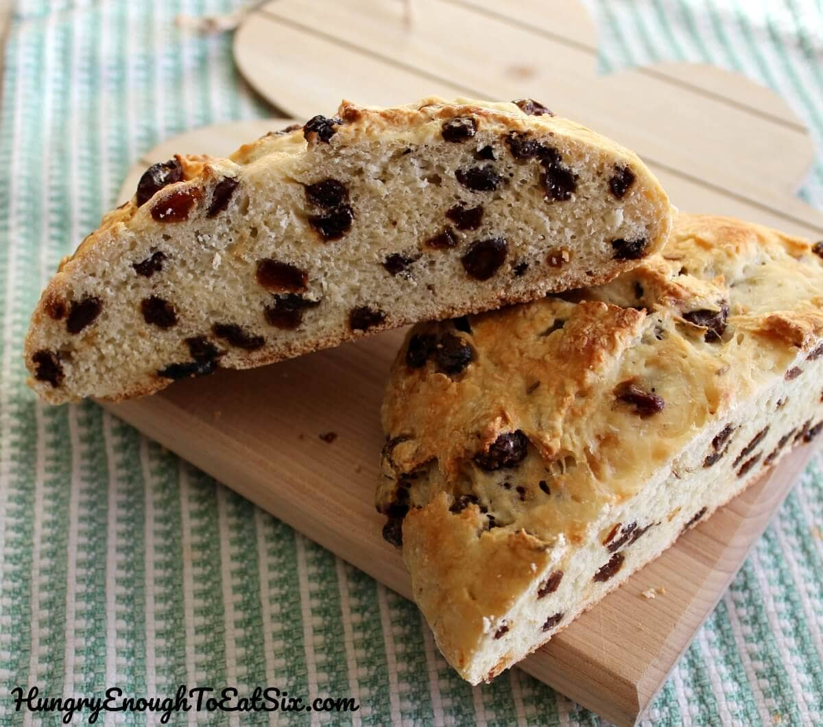 Image of sliced Irish Soda Bread loaf loaded with raisins.