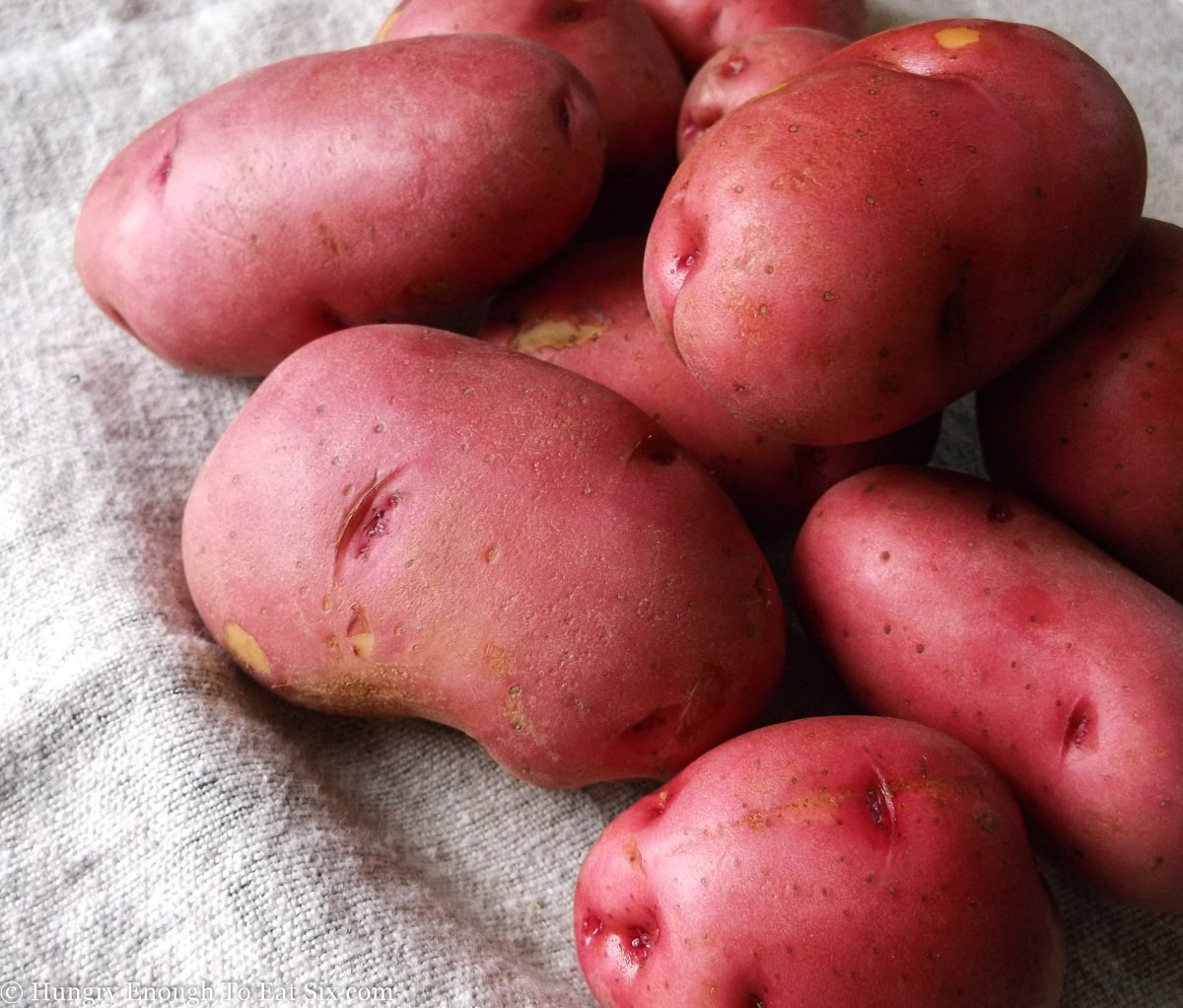 Red potatoes on a coarse cloth