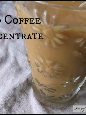 The iced coffee concentrate is made by pouring room temperature water over freshly ground coffee and allowing it to steep. Strain and refrigerate it.