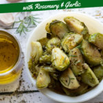 Roasted Brussels sprouts with seasoning and next to olive oil.