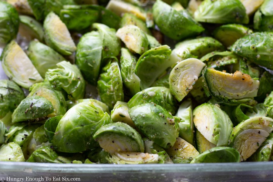 Sliced Brussels sprouts tossed with seasonings.