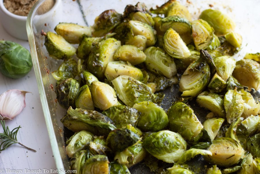 Sliced Brussels sprouts in a baking dish.