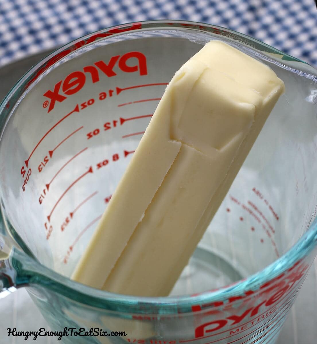 Stick of butter in a Pyrex measuring cup