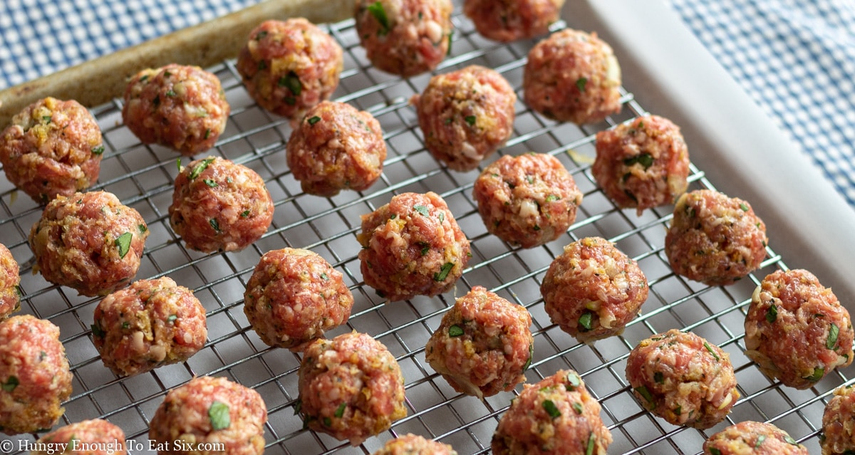 Shaped meatballs line up on a wire rack