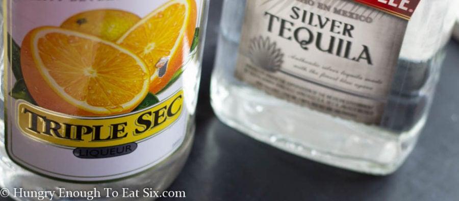 Bottles of Triple Sec liqueur and tequila