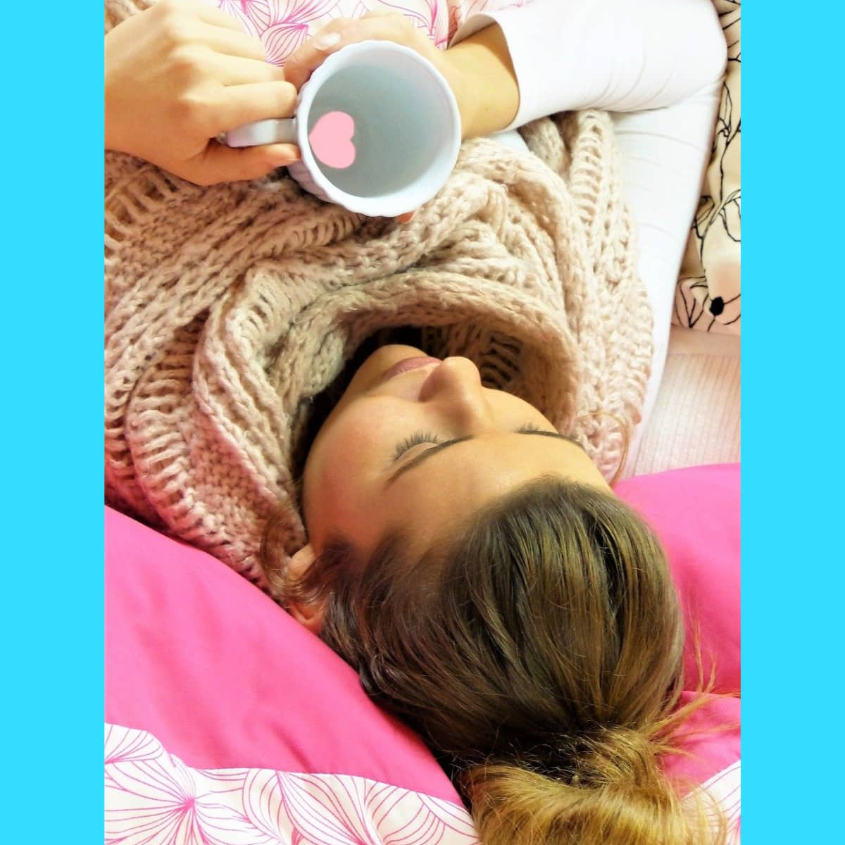 Woman lying down with a mug