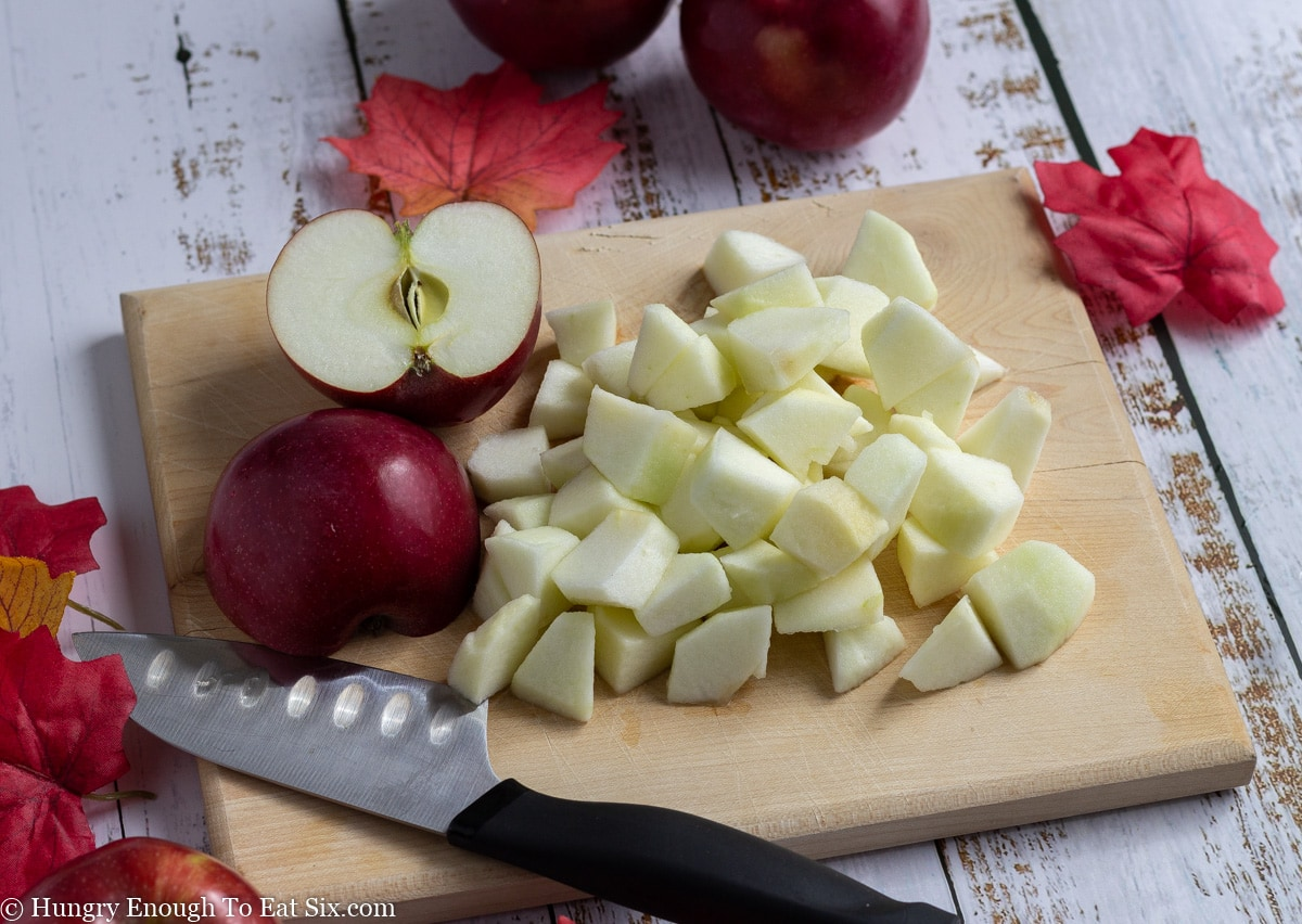 Cutting board with diced apples and a knife