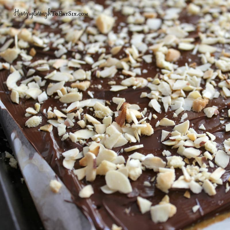 This Award-Winning Trefoils Toffee & Chocolate Bark with Toasted Almonds is a chewy, chocolatey candy with Girl Scouts Trefoils cookies. Easy to create & so delicious!