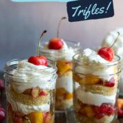 Trifles with cream, cake, nectarines and cherries.