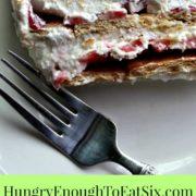 Slice of strawberries and cream cake beside photo of sliced strawberries.