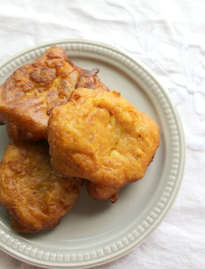 Orange fritters arranged on a small plate