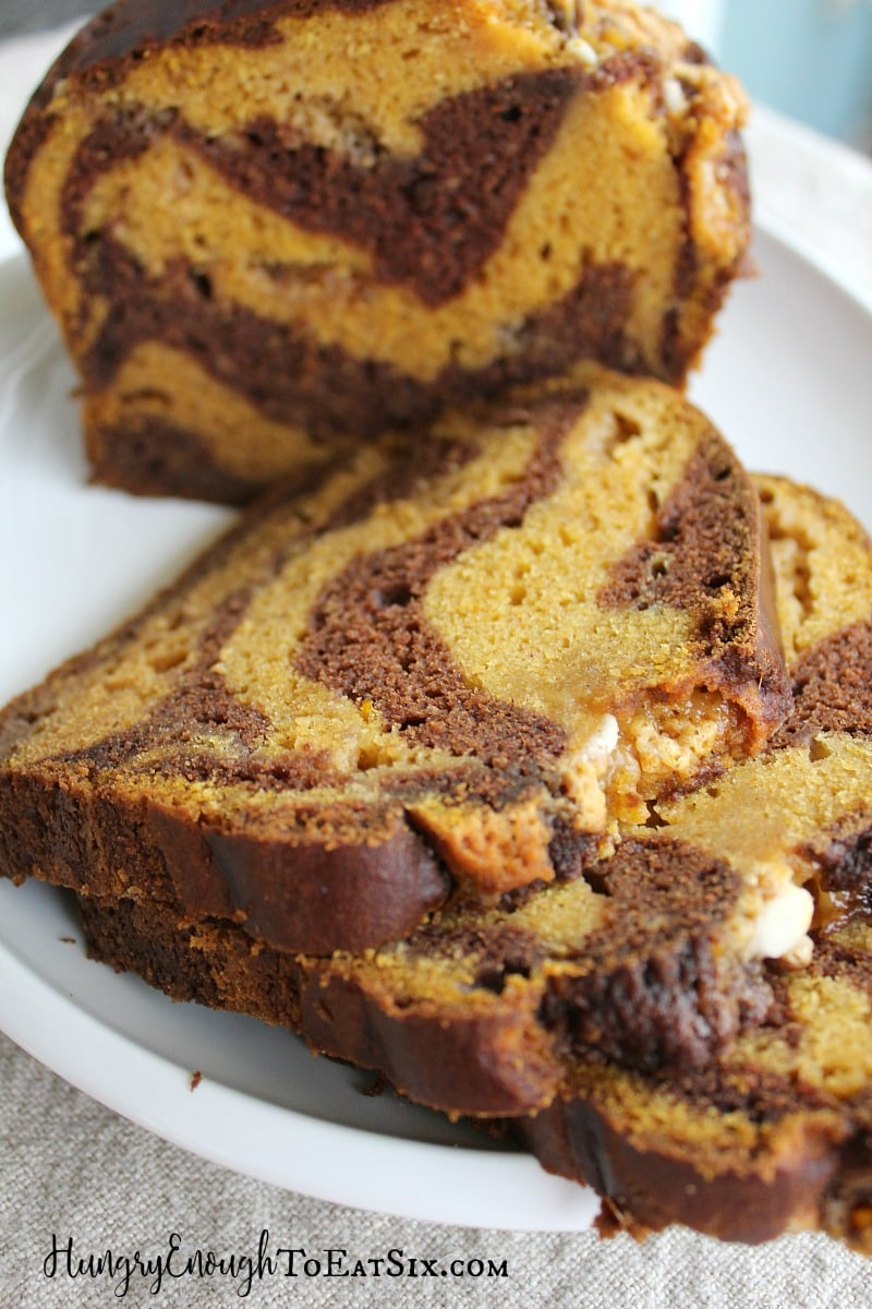 Slices of chocolate pumpkin bread laid out on a plate