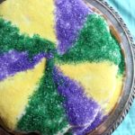 A King Cake for Mardi Gras, with flavors of nutmeg and a cinnamon-pecan streusel. And of course a baby hidden inside one of the Fillables Cake Pan pockets!