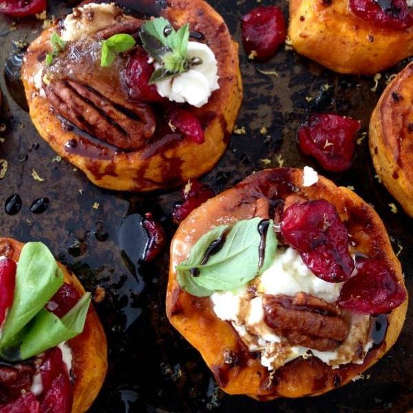 https://ciaoflorentina.com/sweet-potato-rounds-recipe-goat-cheese-cranberries-balsamic-glaze/