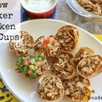 Homemade taco cups combine with Mexican seasoned-chicken made conveniently in the slow cooker! These make an easy appetizer or fun Taco Night dinner.