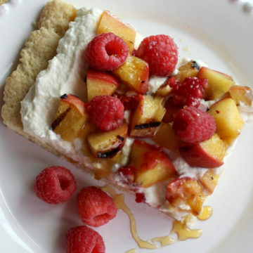 Peaches drizzled honey over cream and shortcake