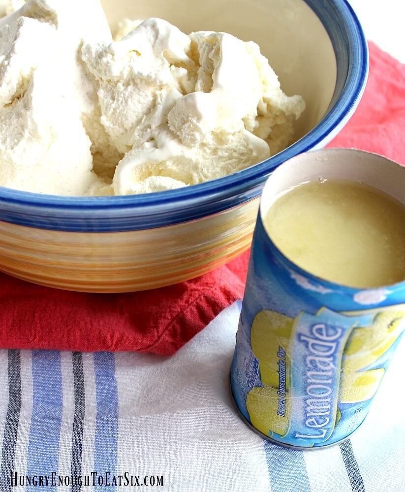 Vanilla ice cream in a yellow and blue bowl next to an opened container of lemonade concentrate.