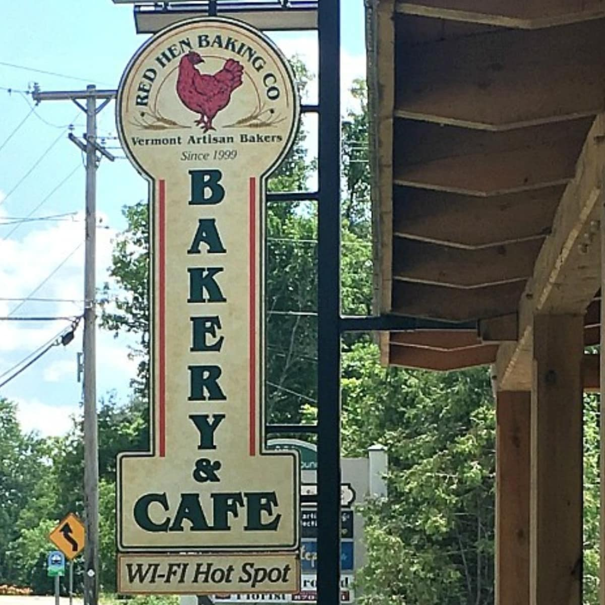 Outside of Red Hen Baking Company with a tall sign.