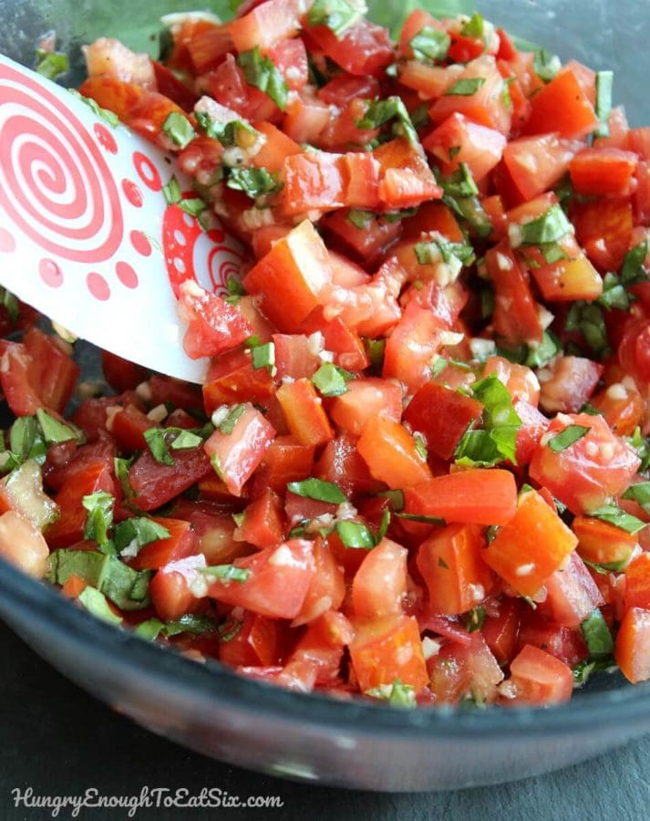 The irresistible combo of basil, garlic and fresh tomatoes come together in this flavorful, summery salsa.