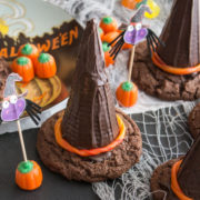 Chocolate cookies and cones assembled to look like witch hats