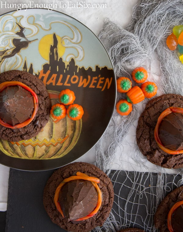 Chocolate cookies with chocolate cones on a Halloween decorated plate.