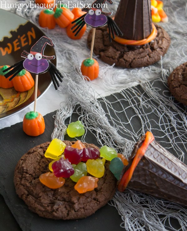 Candies like gummies and pumpkins on a chocolate cookie