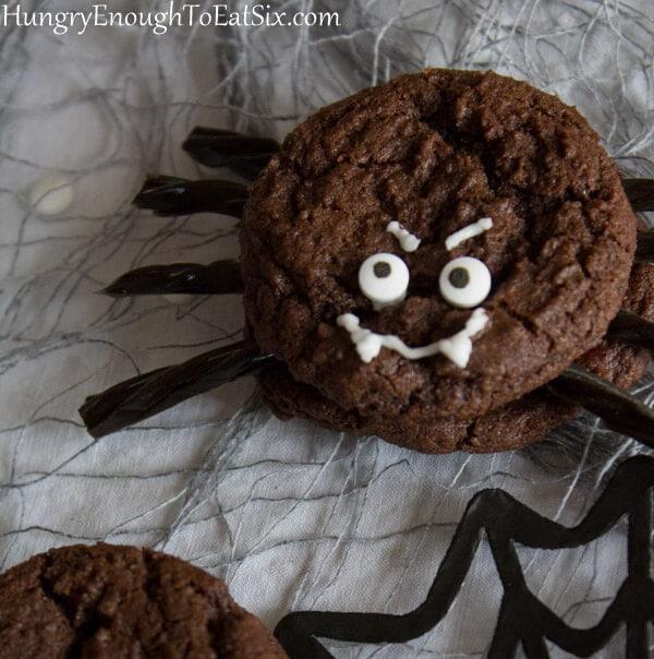 Halloween cookies made to look like spiders of chocolate cookies