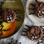 Image of assembled Halloween Spider Sandwich Cookies on Halloween plates and paper webs