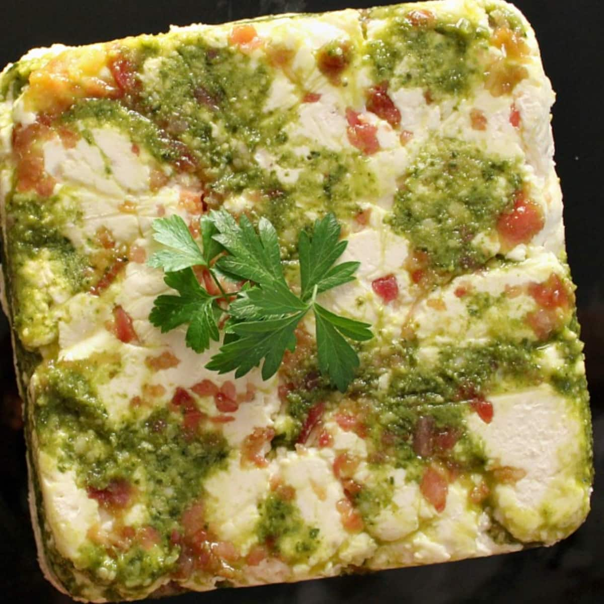 Sqaure of cheese and pesto spread