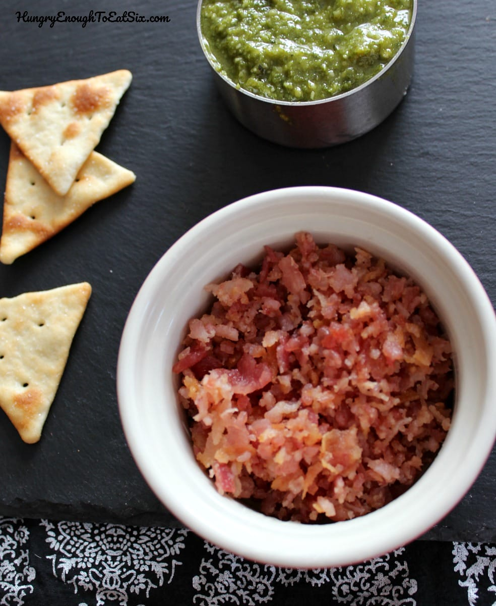 Diced bacon and a bowl of pesto and crackers