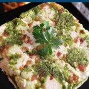 Parsely topped brick of pesto cheese spread