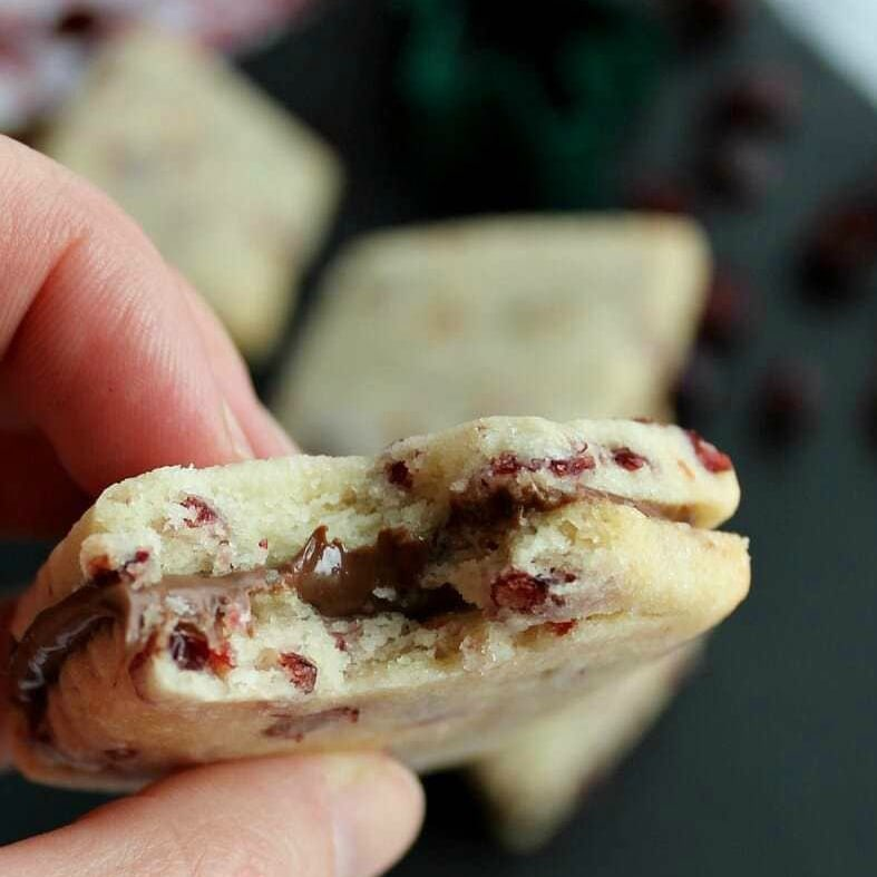 Tender shortbread cookies flecked with cranberry hold the delicious chocolate-hazelnut spread in the center!