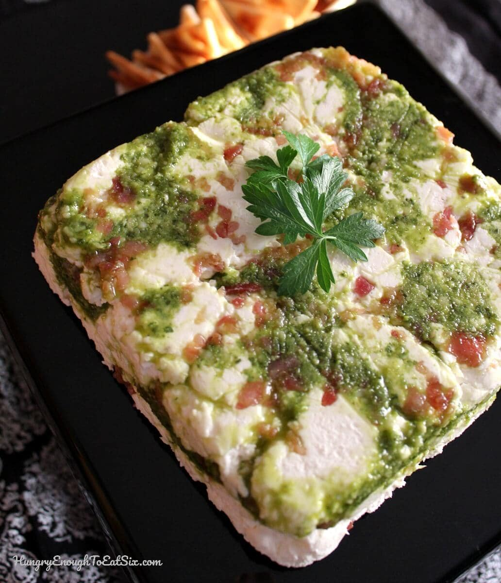 A tantalizing appetizer! Layers of smoky bacon and bright pesto combined with a cream cheese-Parmesan blend.