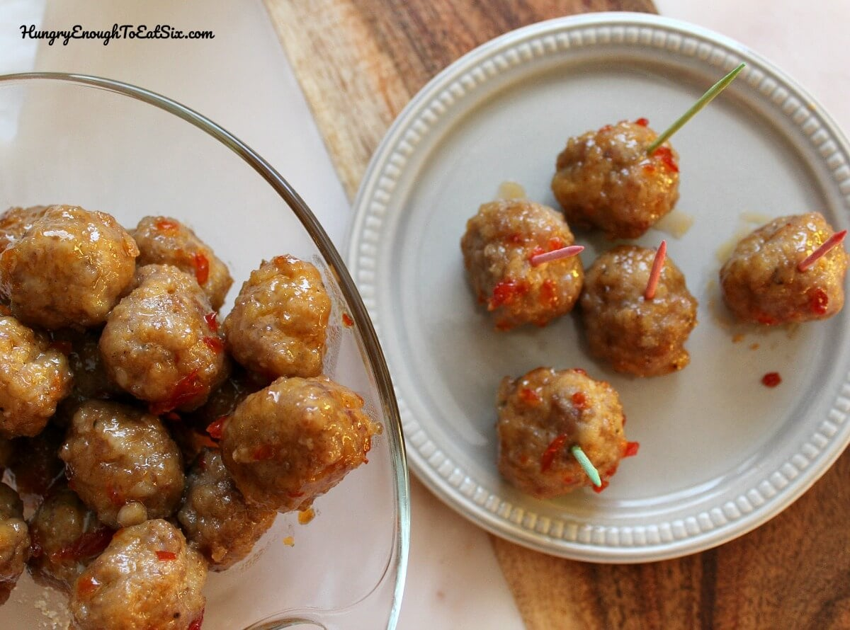 These savory meatballs are delicious for a party or a brunch. The meatballs have a spicy kick inside and a sweet-spicy glaze on the outside.