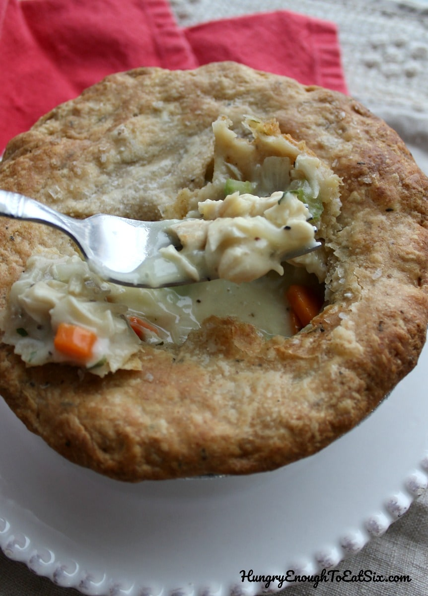 Pie with a fork holding some of the filling
