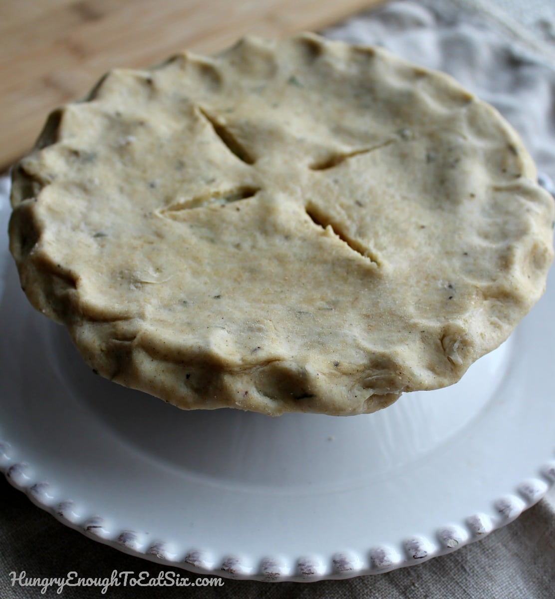Unbaked mini pie on a white plate