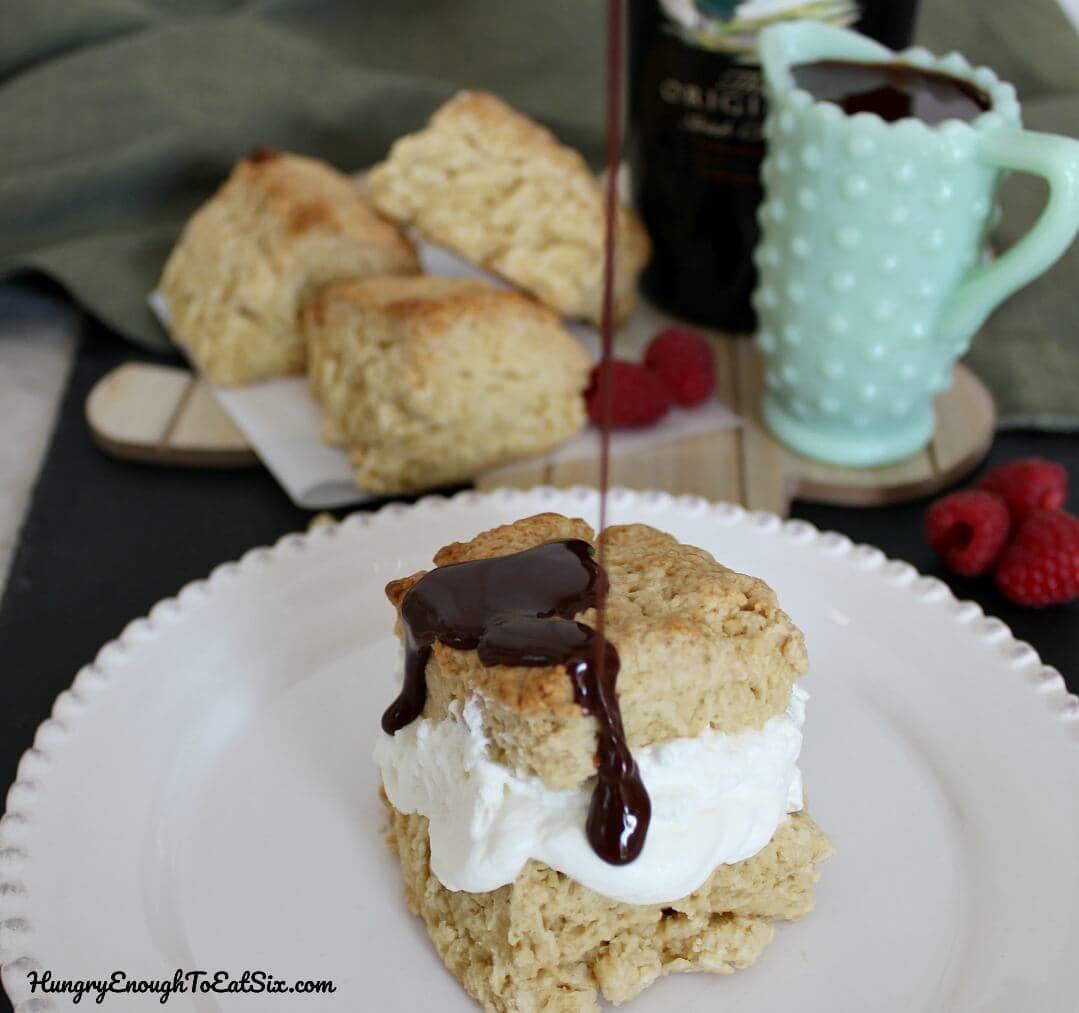 Tender scones full of Bailey's Irish cream flavor become part of a great dessert when topped with fresh whipped cream and whiskey chocolate sauce!