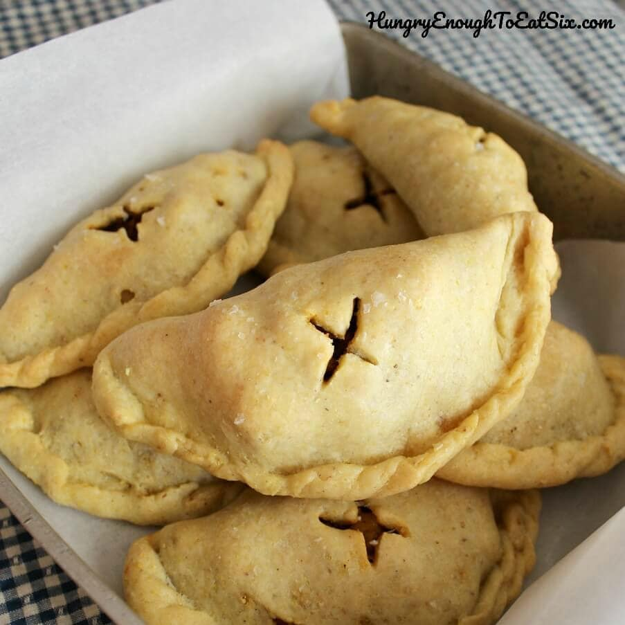 These meat-filled pies are empanadas, and they're filled with a mixture of beef and spicy chorizo, and potato.