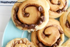 Hot from the oven, the chocolate chips are gooey through the swirl in the cinnamon rolls.