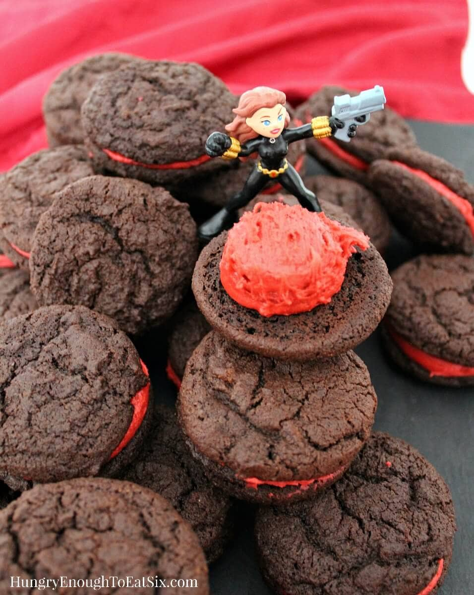 These decadent cookie sandwiches are an homage to The Avengers and to Black Widow! A rich chocolate and buttercream treat.