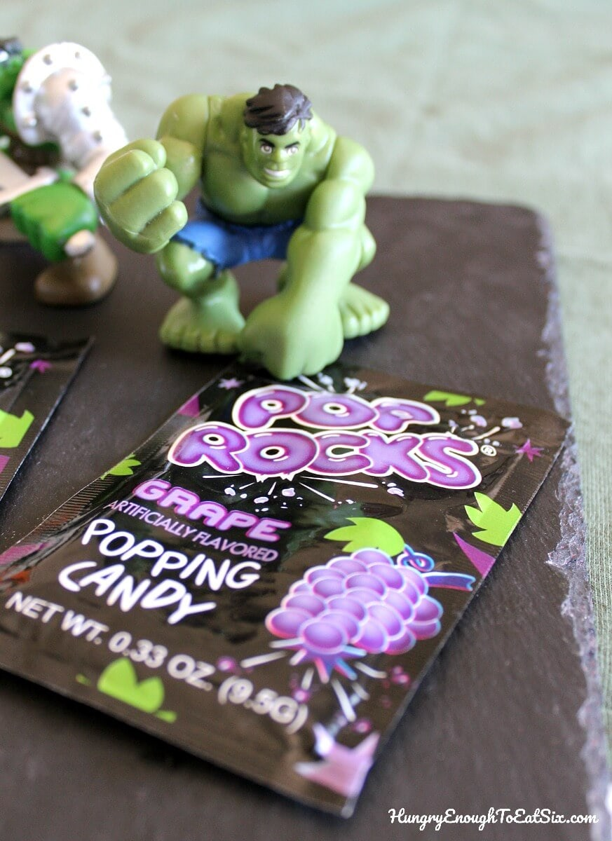 Hulk toy next to package of grape Pop Rocks