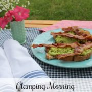 Outdoor table with blue checked cloth and plate of avocado toast