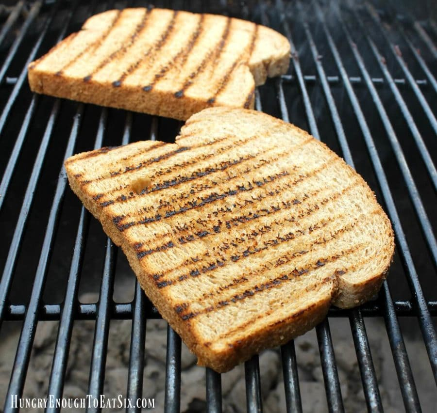 Bread on grill grates with black grill marks