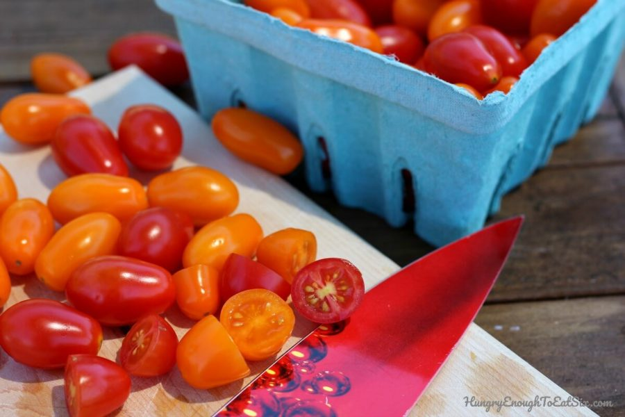 Fresh orange and red cherry tomatoes