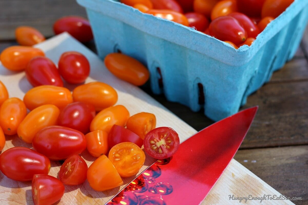 Image of fresh orange and red cherry tomatoes