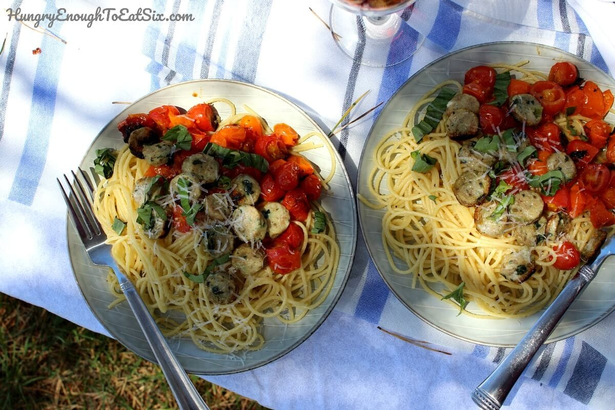 Image of plates of Fireside Pasta with Fresh Tomatoes, Basil and Chicken Sausage