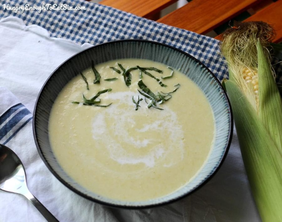 Image of Chilled Sweet Corn Soup in a bowl with fresh herbs on top